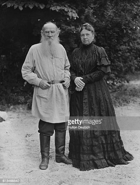The Russian writer and philosopher Count Leo Tolstoy photographed with his wife Sonya in their garden, ca. 1906. | Location: Yasnaya Polyana, Russia.