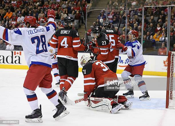 TORONTO ON DECEMBER 19 The Russians get one by Zachary Fucale in second period action as the Team Canada plays Team Russia in a 2015 IIHF World...