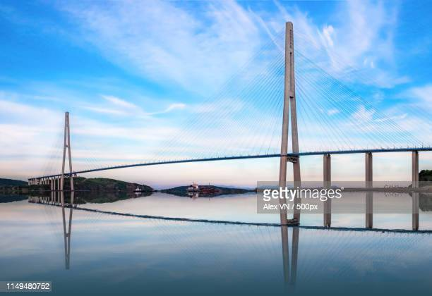 the russky or russian bridge to russky island is in vladivostok provides communication with the - new bay bridge stock pictures, royalty-free photos & images
