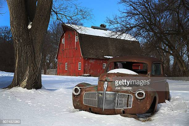 The rusted body of an old car sits near a barn on January 29, 2016 in Fenton, Iowa. Candidates who are seeking the nominations from the Republican...