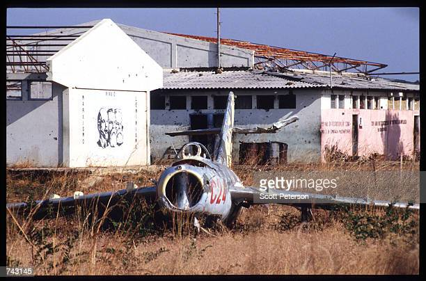 The rusting hulk of a Sovietbuilt MIG17 sits on a field June 7 1992 in Caimbambo Angola Angola has been engulfed in civil war and political strife...