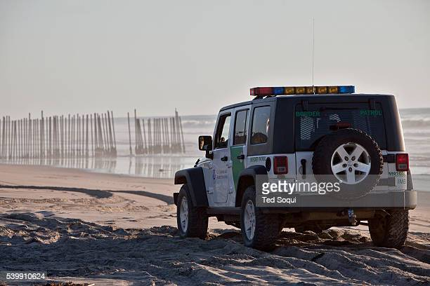 The rusty border fence that separates the US and Mexico extends briefly in to the Pacific Ocean The once porous beach border area is now highly...