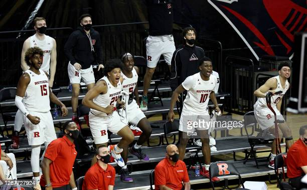 The Rutgers Scarlet Knights bench erupts after teammate Dean Reiber dunked in the second half against Sacred Heart Pioneers during the season opening...