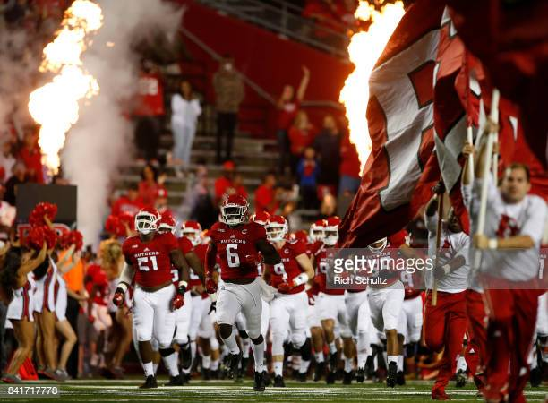The Rutgers Scarlet Knights run onto the field before a game against the Washington Huskies on September 1 2017 in Piscataway New Jersey Washington...