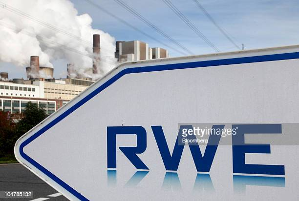 The RWE AG logo is seen at the company's brown coal open cast mine in Weisweiler Germany on Monday Oct 4 2010 German Economy Minister Rainer...