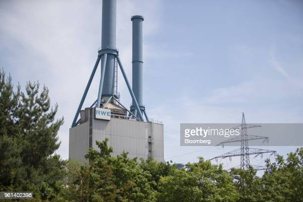 The RWE AG logo sits on a building at the company's gas powered power plant in Lingen Germany on Tuesday May 22 2018 RWE is transforming to focus on...