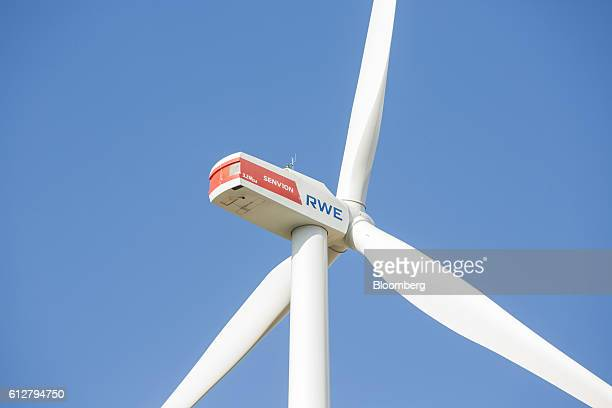 The RWE AG logo sits on a wind turbine nacelle on the Innogy SE wind farm in Bedburg Germany on Tuesday Oct 4 2016 RWE's green energy business Innogy...