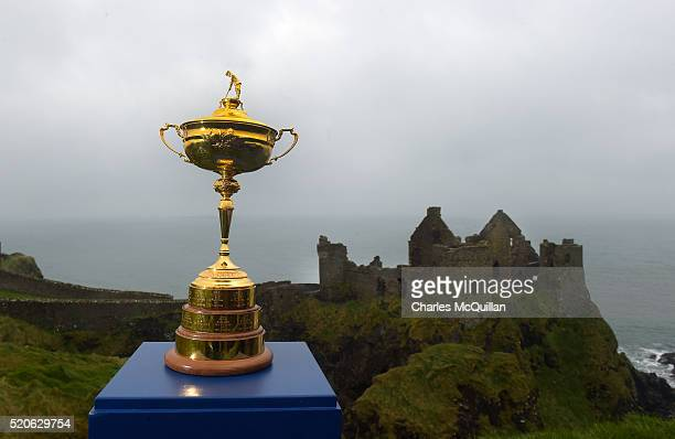 The Ryder Cup is viewed against the backdrop of the historic Dunluce Castle ruins as part of the Ryder Cup Trophy Tour launch on April 12 2016 in...