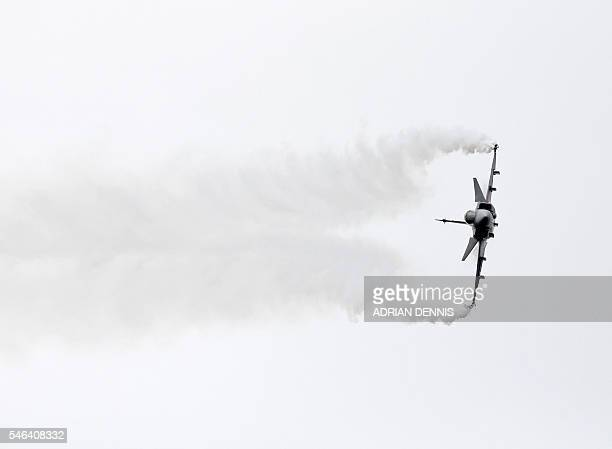The Saab JAS 39 Gripen fighter aircraft takes part in a flying display at the Farnborough Airshow south west of London on July 12 2016 / AFP / ADRIAN...