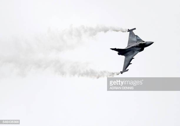 The Saab JAS 39 Gripen fighter aircraft takes part in a flying display at the Farnborough Airshow south west of London on July 12 2016