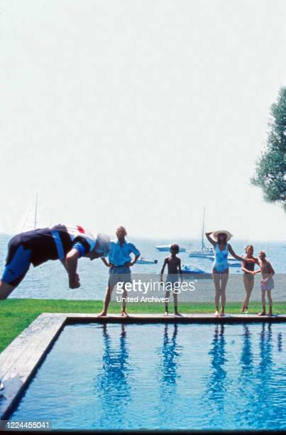 The Sachs family having fun when father Gunter jumps into the pool.