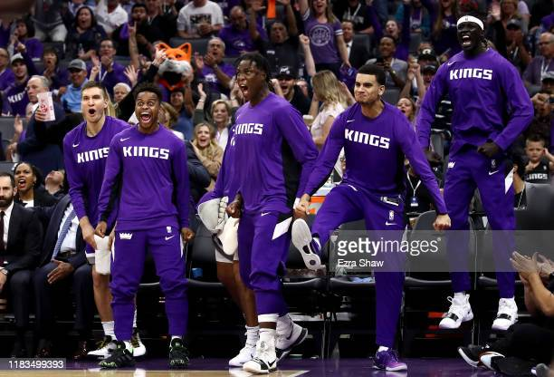 The Sacramento Kings bench reacts after Harrison Barnes dunked the ball against the Portland Trail Blazers at Golden 1 Center on October 25, 2019 in...