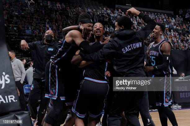 The Sacramento Kings celebrate after the game against the Cleveland Cavaliers on March 27, 2021 at Golden 1 Center in Sacramento, California. NOTE TO...
