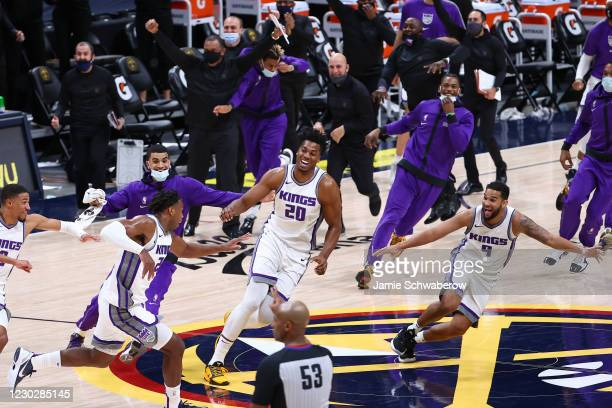 The Sacramento Kings celebrate their last-second victory over the Denver Nuggets at Ball Arena on December 23, 2020 in Denver, Colorado. NOTE TO...