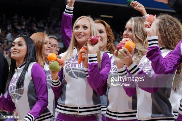 The Sacramento Kings dance team hand out gifts during the game against the Denver Nuggets on January 6 2018 at Golden 1 Center in Sacramento...