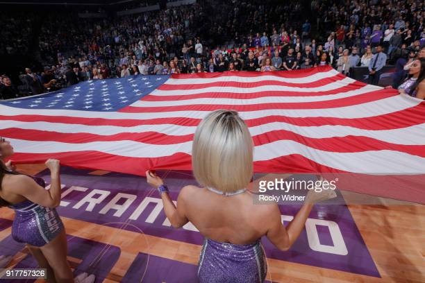 The Sacramento Kings dance team holds onto the American flag during the national anthem of the game against the Dallas Mavericks on February 3 2018...