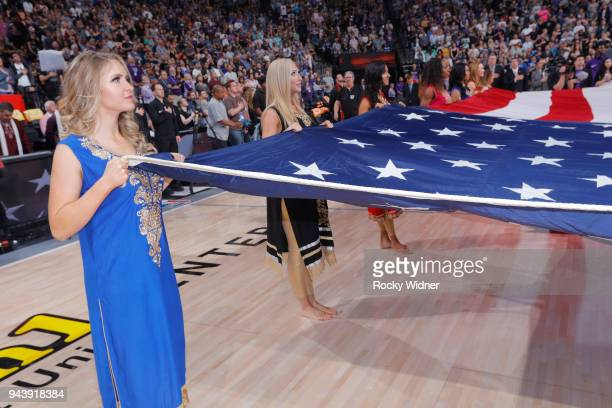 The Sacramento Kings dance team holds up the American flag during the national anthem of the game against the Golden State Warriors on March 31 2018...