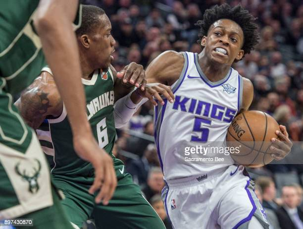 The Sacramento Kings' De'Aaron Fox drives to the basket against the Milwaukee Bucks' Eric Bledsoe on November 28 at Holden 1 Center in Sacramento...