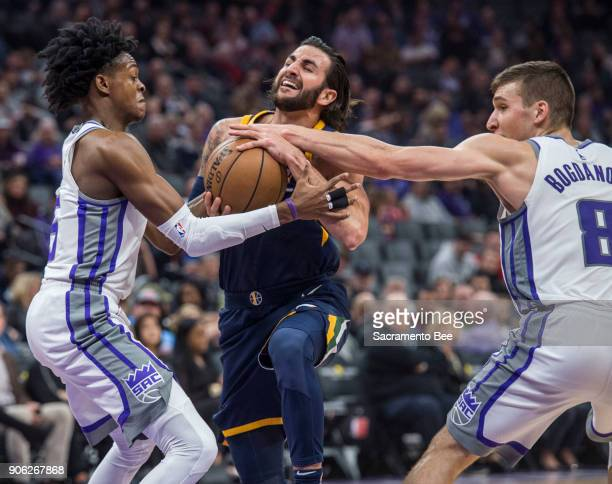 The Sacramento Kings guard De'Aaron Fox and Bogdan Bogdanovic defend Utah Jazz guard Ricky Rubio as he drives to basket at the Golden 1 Center in...