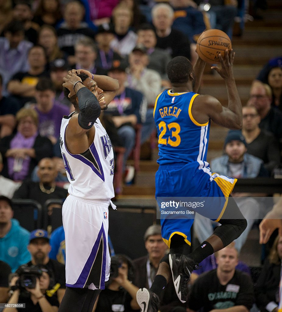 The Sacramento Kings' Jason Thompson, left, reacts after getting called for a foul on the Golden State Warriors' Draymond Green (23) in the second quarter at Sleep Train Arena in Sacramento, Calif., on Tuesday, Feb. 3, 2015.