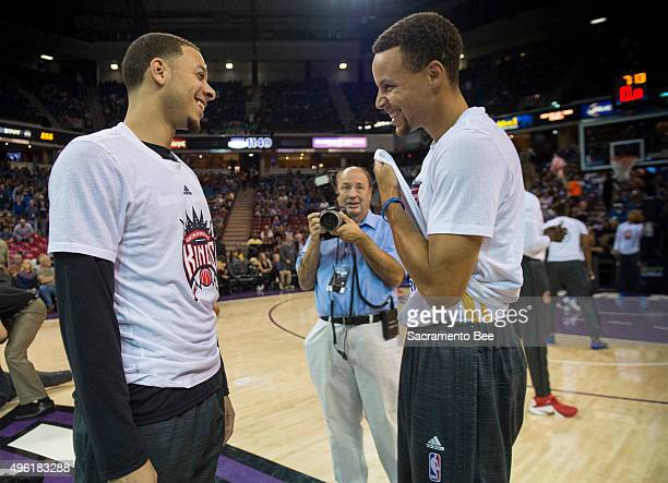 The Sacramento Kings' Seth Curry left talks with his brother Golden State Warriors guard Stephen Curry before a game at Sleep Train Arena in...