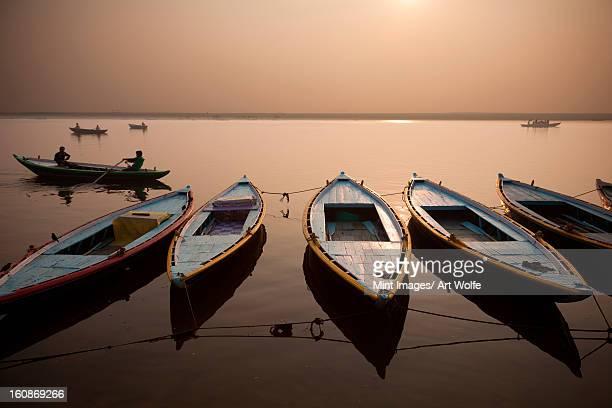 The sacred Ganges River at dawn, in Varanasi, India