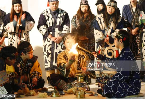 The sacred torch for the 2017 Asian Winter Games is ignited on Feb 5 using a traditional firestarting method of the Ainu indigenous people in Sapporo...