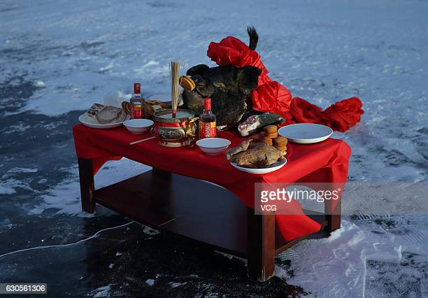 The sacrifices are seen during a ritual before the winter fishing at Shitoukoumen Reservoir on December 25 2016 in Changchun Jilin Province of China...