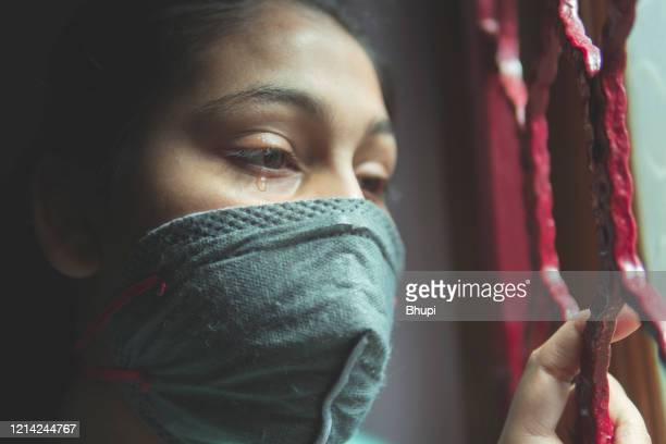the sad girl is protecting herself and wearing a mask against the corona virus - maharashtra stock pictures, royalty-free photos & images