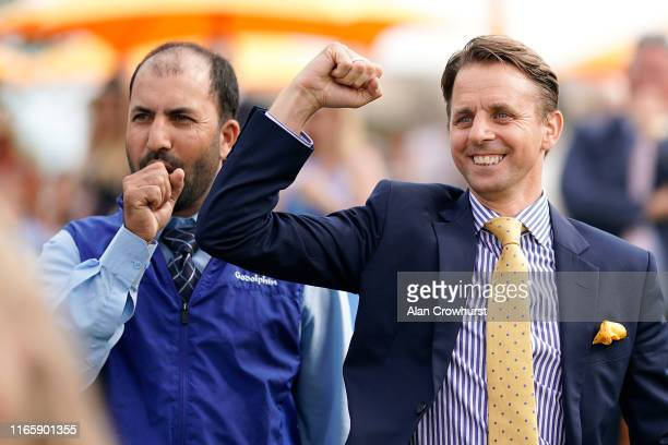 The Saeed bin Suroor stable staff celebrate victory at Goodwood Racecourse on August 03 2019 in Chichester England