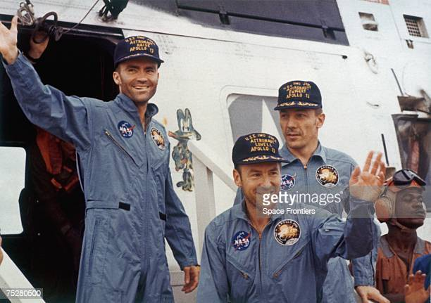 The safe return of the Apollo 13 astronauts after their lunar landing mission encountered technical difficulties 17th April 1970 From left to right...