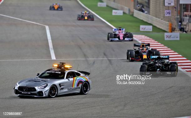 The safety car leads drivers during the Bahrain Formula One Grand Prix at the Bahrain International Circuit in the city of Sakhir on November 29,...