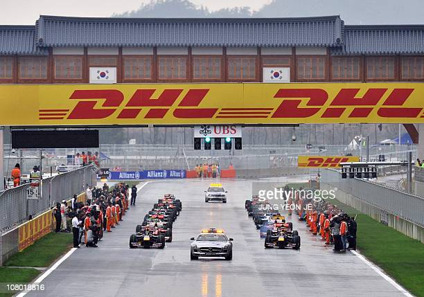 The safety car leads drivers through wet weather conditions in a second start of the South Korean Formula One Grand Prix at the Korean International...