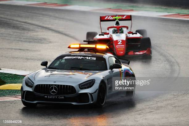 The safety car leads Frederik Vesti of Denmark and Prema Racing in the rain during the feature race for the Formula 3 Championship at Red Bull Ring...
