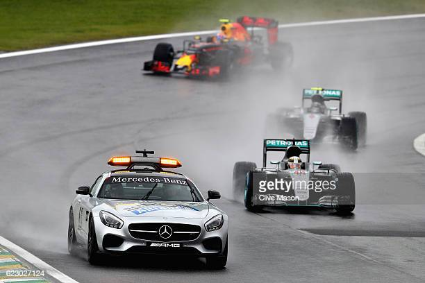 The safety car leads Lewis Hamilton of Great Britain driving the Mercedes AMG Petronas F1 Team Mercedes F1 WO7 Mercedes PU106C Hybrid turbo and Nico...