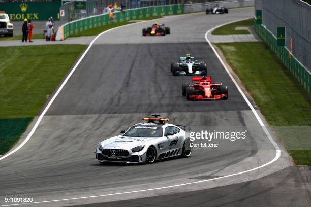 The safety car leads Sebastian Vettel of Germany driving the Scuderia Ferrari SF71H on track during the Canadian Formula One Grand Prix at Circuit...