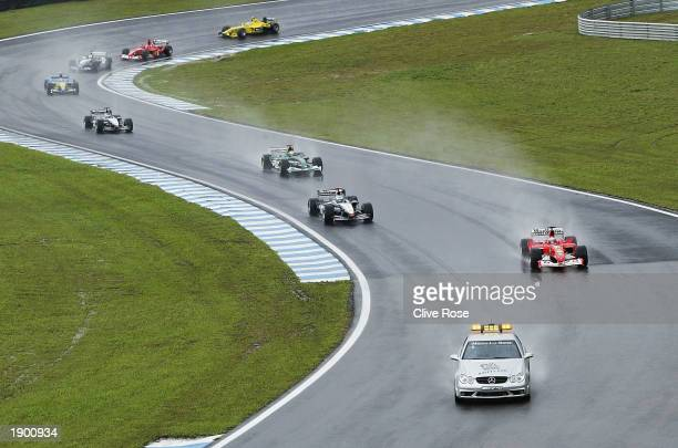 The safety car leads the race cars around at the start of the Formula One Brazilian Grand Prix at Interlagos, Sao Paulo, Brazil on April 6, 2003.