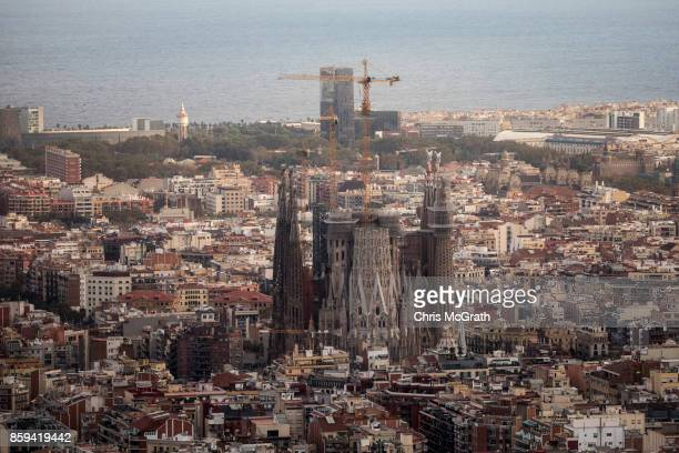 The Sagrada Familia is seen from a hillside ahead of tomorrow's Parliamentary address on October 9 2017 in Barcelona Spain Tension between the...