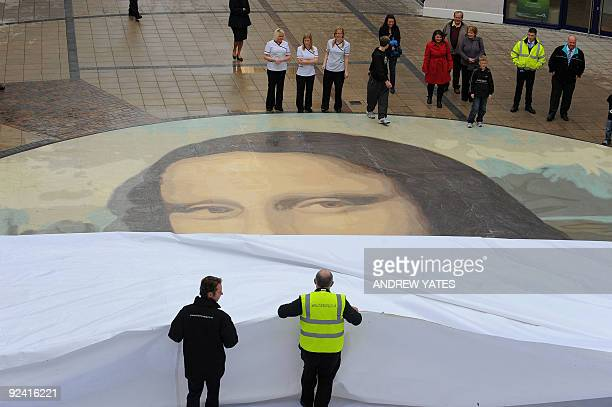 The said to be world's largest paint by numbers Mona Lisa reproduction is unveiled at the Eagles Meadow shopping centre in Wrexham, north Wales, on...