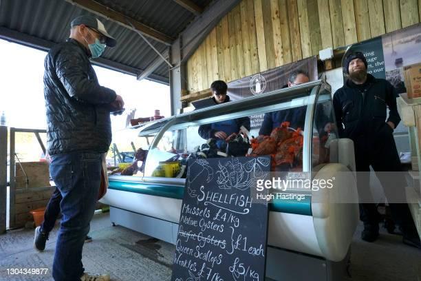 The Sailors Creek Shellfish stall in the Food Barn, Tregew on February 27, 2021 in Flushing, near Falmouth, United Kingdom. Sailors Creek Shellfish...