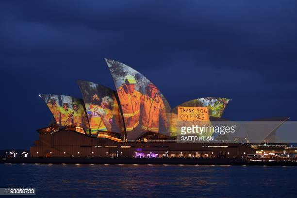 The sails of the Opera House are lit with a series of images to show support for the communities affected by the bushfires and to express the...