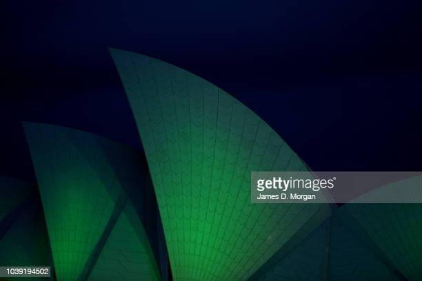 The sails of the Opera House as they are lit green at the Sydney Opera House on September 24 2018 in Sydney Australia The Sydney Opera House has...