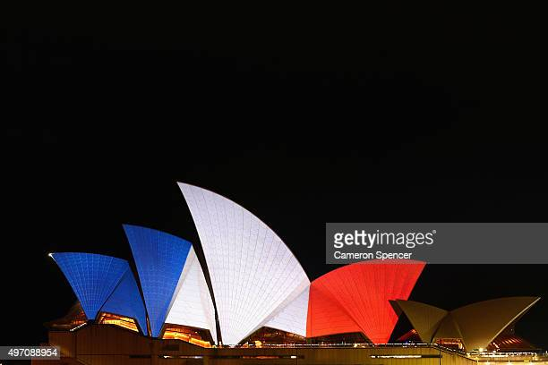 The sails of the Sydney Opera House are illuminated in the colours of the French flag on November 14 2015 in Sydney Australia At least 120 people...