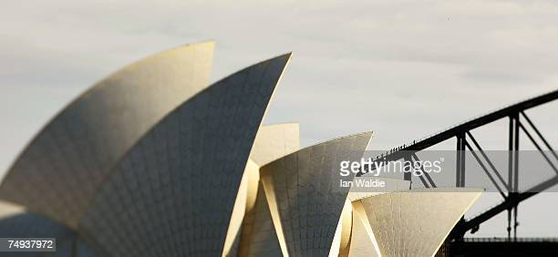The sails of the Sydney Opera House are set against the Sydney Harbour Bridge June 28 2007 in Sydney Australia The Opera House designed by Joern...