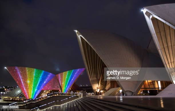 The sails of the the Sydney Opera House are illuminated with the rainbow flag on December 8 2017 in Sydney Australia Australia's parliament voted to...