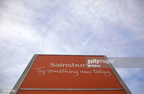 The Sainsbury's logo sits on a sign outside the company's distribution center in Waltham Abbey UK on Tuesday Dec 6 2011 J Sainsbury Plc the UK's...