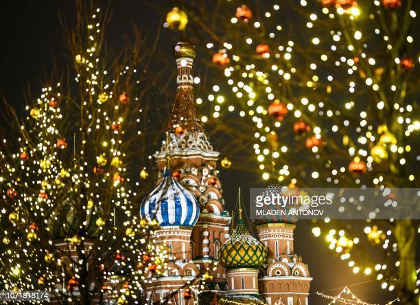 The Saint Basil's Cathedral is surrounded by Christmas and New Year decoration on the Red Square in Moscow on December 11 2018