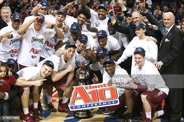 The Saint Joseph's Hawks celebrate after defeating the Virginia Commonwealth Rams during the Championship game of the 2014 Atlantic 10 Men's...