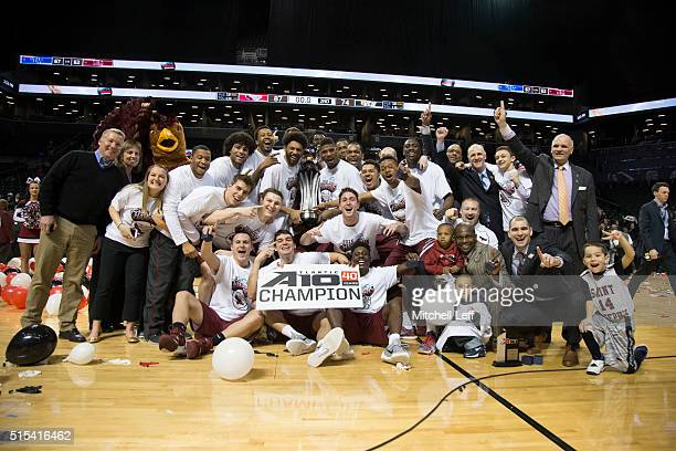 The Saint Joseph's Hawks pose for a team picture after the game against the Virginia Commonwealth Rams in the championship game of the men's Atlantic...