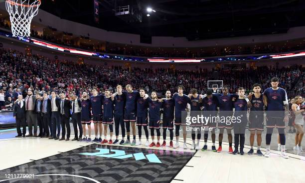 The Saint Mary's Gaels stand on the court as the American national anthem is performed before the championship game of the West Coast Conference...